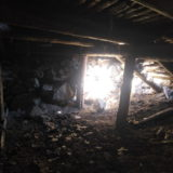 Abandoned house interior. Archaeologization process of debris accumulation.