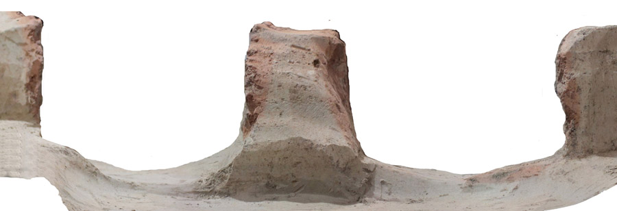 The cut of LaTene two-chamber pottery kiln with overburning traces on yellow loess.